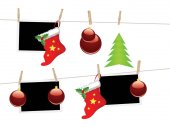 Red Christmas stockings hanging on a rope with wood pegs
