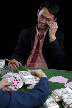 The young gambler is stressed when contender gathered a pile of