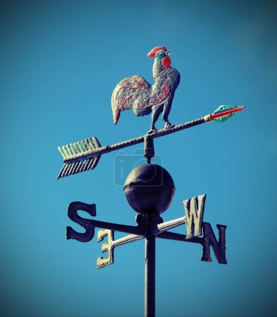 Photo for Weathervane to indicate the wind direction and lomo effect - Royalty Free Image