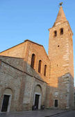 ancient church and bell tower of Santa Eufemia in the city calle