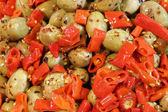 salad of green olives with peppers and oregano typical dish of M