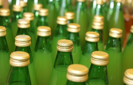 green bottles with golden cover