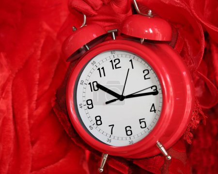 red alarm clock on red background
