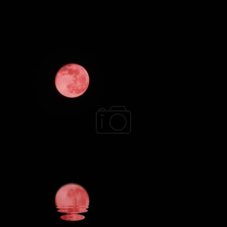red full moon on a dark night without stars