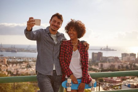 Happy young couple posing for selfie