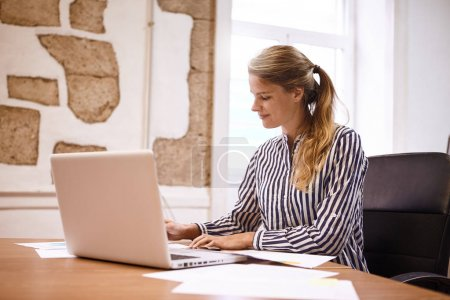 Professional young woman preparing for meeting