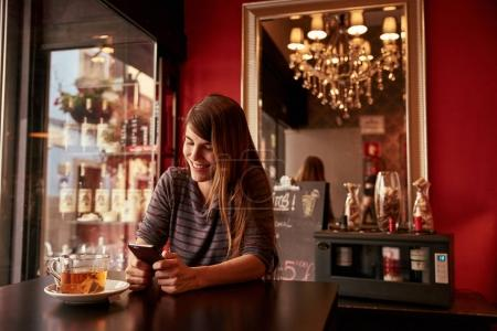 young lady sitting in bar