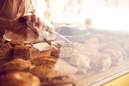 Deli display of cookies, cakes, pasties
