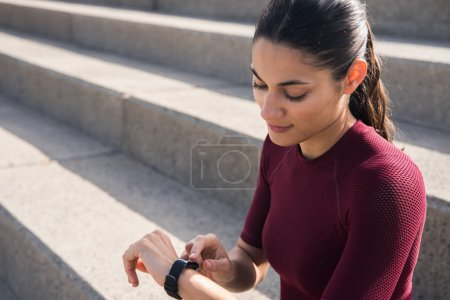 Attractive woman looking at smartwatch