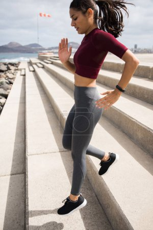 Attractive woman running down stairs