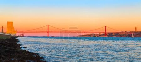 Photo for 25th of April Bridge (The 25 de Abril Bridge, Ponte 25 de Abril) is a suspension bridge connecting the city of Lisbon, capital of Portugal, to the municipality of Almada - Royalty Free Image