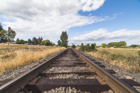 Train Tracks Under Summer Sky