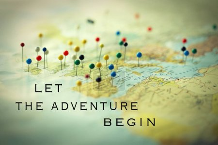 Photo for Inspirational quote Let the adventure begin on a map full of pines on different country and city - Royalty Free Image