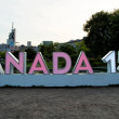 Постер, плакат: Pink sign for 150 celebration of Canada