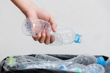 Plastic bottles in black garbage bags waiting to be taken to recycle.