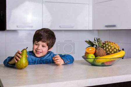 Little boy with a bowl of fresh fruits