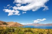 Sevan lake and white clouds blue sky on a sunny day, Armenia