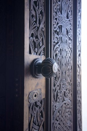 detailed view of entrance carved wooden door in Surb Astvatsatsin Church (Holy Mother of God) of Noravank Monastery, 13th-century, Vayots Dzor, Armenia. popular colour effect