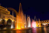 Yerevan, Republic Square, Armenia - October 14, 2017: Colored singing musical dancing fountains against the building of the National Gallery and History Museum of Armenia. Beautiful night cityscape