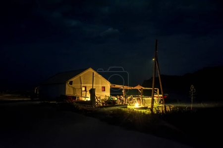 Dramatic scene with lonely old house at night on Erikousa island, Greece