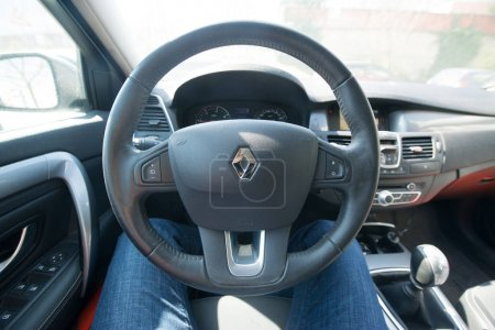 Driver sitting at the steering
