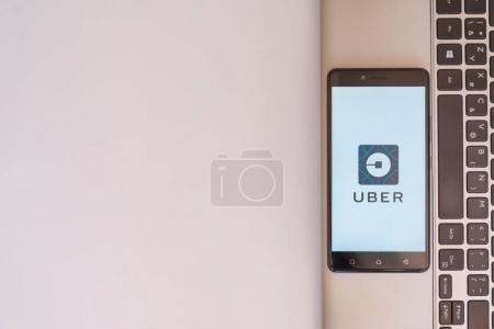 Uber logo on smartphone