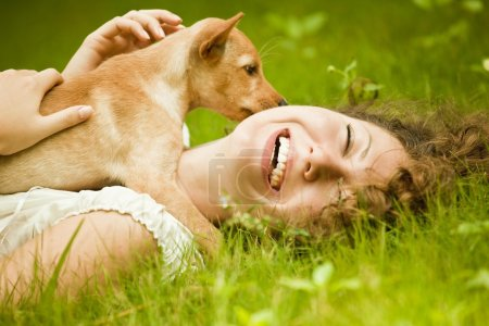 Happy woman with her dog in the park