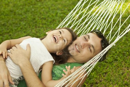 Dad and daughter in a hammock