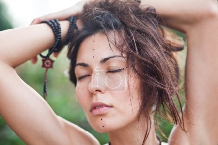 Hippie girl with closed eyes
