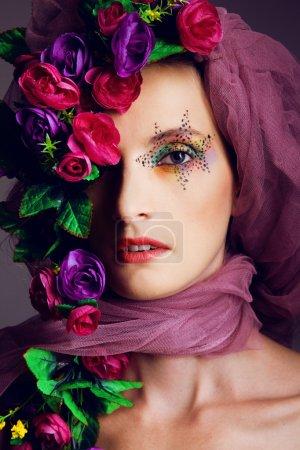 Portrait of a woman in flowers