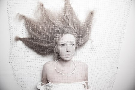 pale woman in cocoon