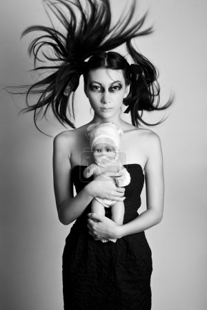 Young Black widow girl with a doll, black and whit...