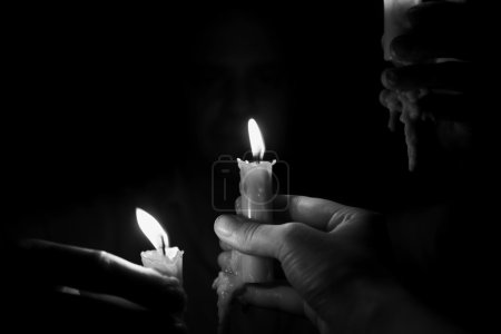 Candles in male hands
