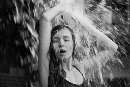 Girl splashing water