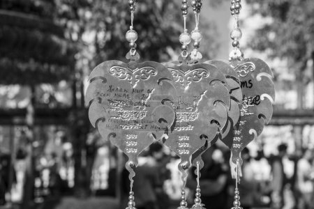 CHIANG RAI, THAILAND - DECEMBER, 2017: Wat Rong Khun, White Temple, decorated silver metal leaves for wishes and thoughts, monochrome