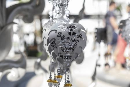 CHIANG RAI, THAILAND - DECEMBER, 2017: Wat Rong Khun, White Temple, decorated silver metal leaves for wishes and thoughts