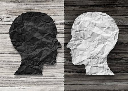 Photo for Bipolar mental health and brain disorder concept as a human head in paper divided in two colors as a neurological mood and emotion symbol or medical psychological metaphor for social behavior challenges in a 3D illustration style. - Royalty Free Image