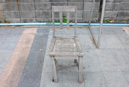 Old broken wood chair in the public park