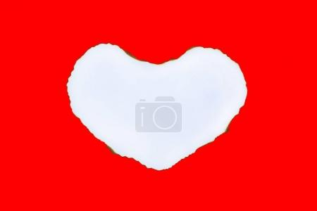 Paper Burning in shape of heart on red background