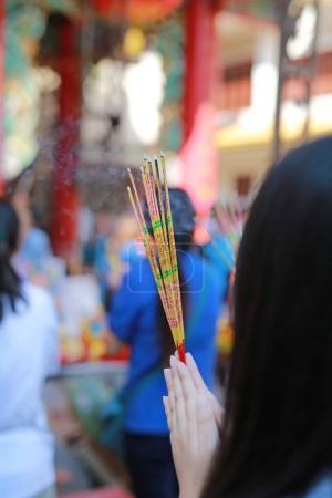 People pray respect with Incense burning for god in Chinese New Year day at chinese temple in bangkok, Thailand.