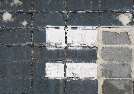 Background of old grey block wall with some white painted color.