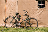 Old Bicycle Parked Next To Large Soviet Military Canvas Khaki Tent