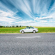 Постер, плакат: Volkswagen Polo Car Parking On A Roadside Of Country Road On A B