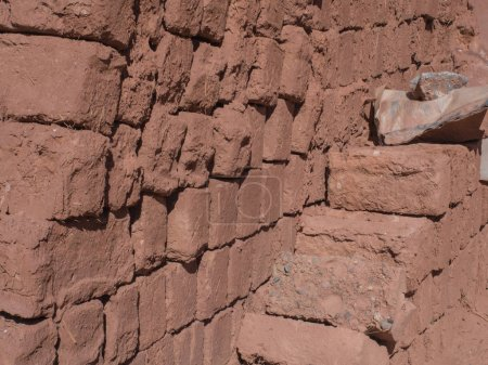 Red bricks made of clay, dried on the sun