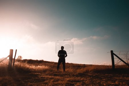 Guy standing in wheat field