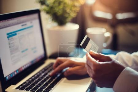 Businessman using credit card online