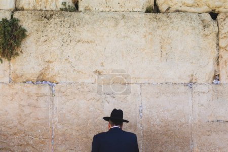 Jew standing in front of Wailing Wall