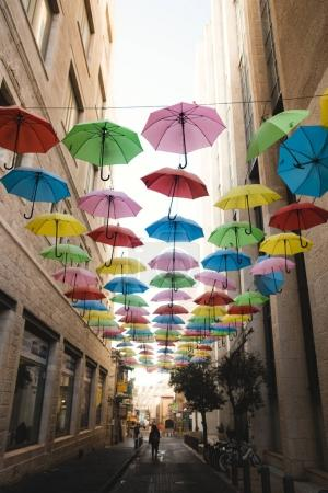 Bright umbrellas hanging over side street