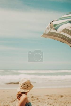 young woman on ocean Beach  in summer.