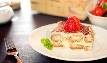 Photo for Tiramisu cake decorated with strawberries Italian cuisine, Selective focus - Royalty Free Image